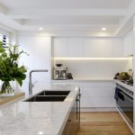LED Lighting strip under floating cabinets in a kitchen