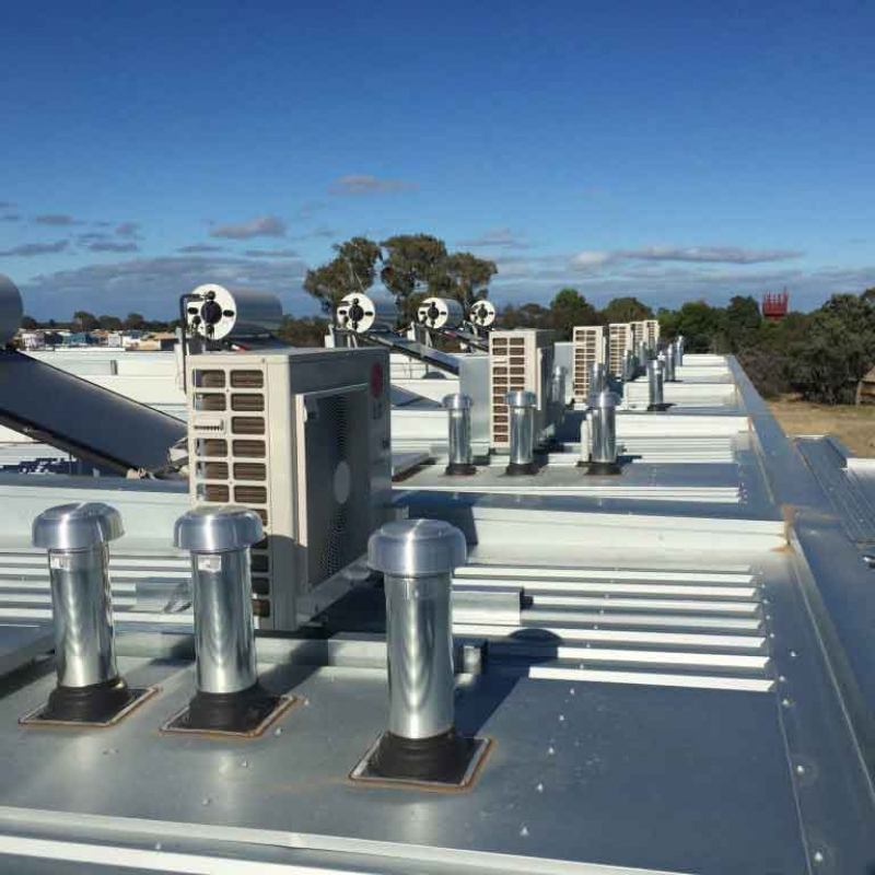 Evaporative Air Conditioner outdoor units installed on a roof in a row