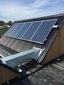 Solar panels installed on a roof with a very steep pitch